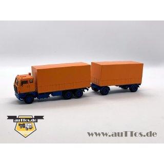 DEUTRANS-Hängerzug Volvo F88 6x2 Pritsche/Plane orange/blau